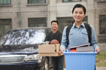 35985484 - student portrait in front of dormitory at college