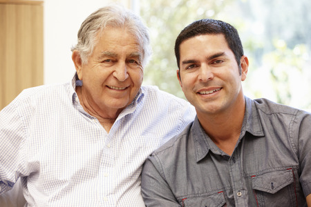 42109283 - hispanic father and adult son