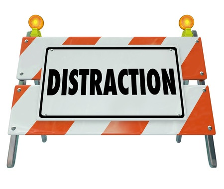 39940541 - distraction word on a road construction barrier or sign to illustrate dangerous inattentive driving or hazardous situation